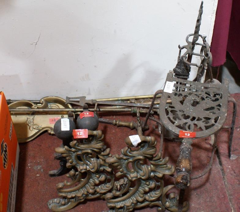 mccartneys a pair of brass rococo fire dogs a trivet and other