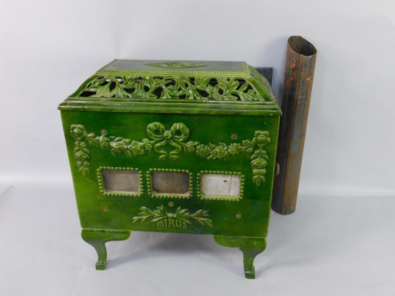 A Mirus Green Enamelled Heater With Pierced And Embossed Floral Foliate Decoration Raised On Cabriole