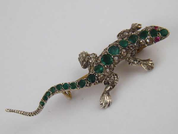 a4465986d6c An emerald and rose cut diamond brooch designed as a lizard, ruby eyes,  largest emerald approx 3.9mm