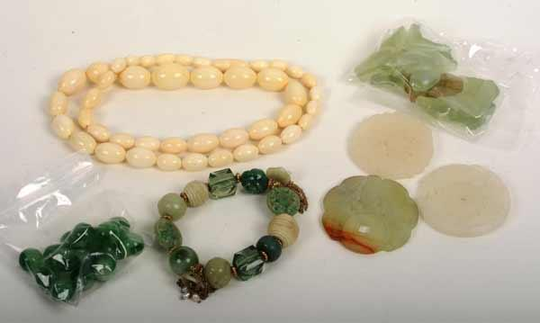 94f43ad7d An ivory style graduated bead necklace, together with a green bead and  carved hardstone bracelet, three