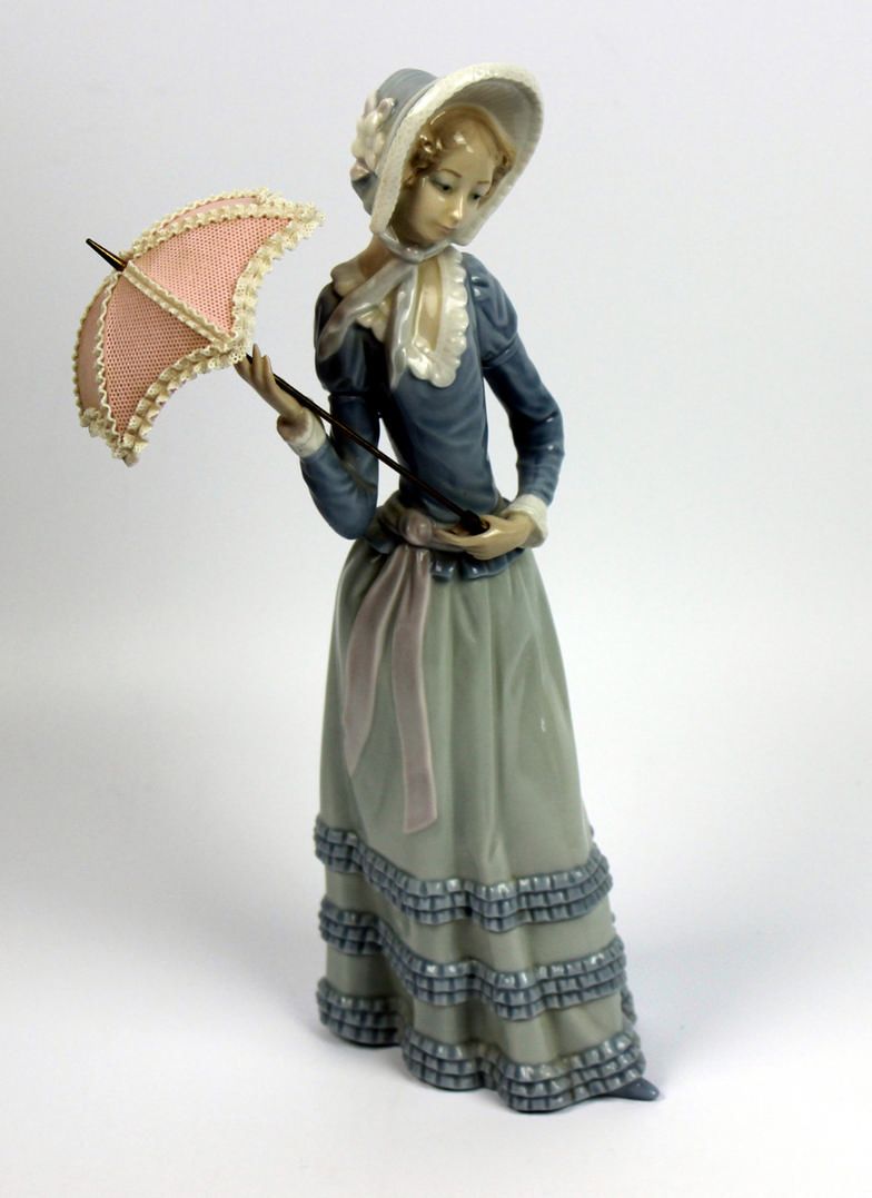 Golding Young Mawer Bourne A Lladro Figure Of A Girl With