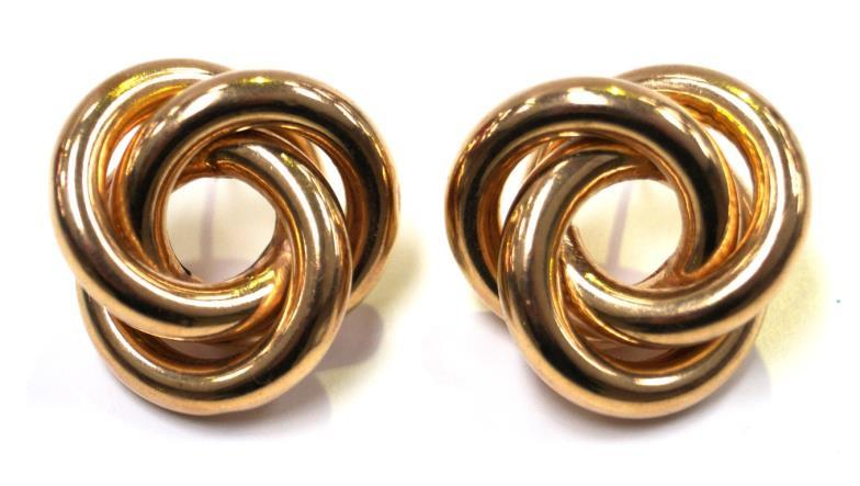 1200ab1b1 A pair of 9ct gold ear studsOf large knot form, with ear posts, weight  combined 11g