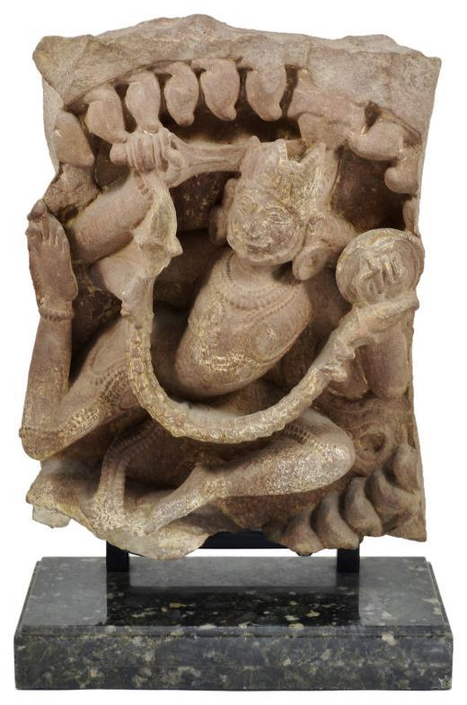 An antique fragmentary roundel depicting a Gandharva, central India, probably Madhya Pradesh, circa 11th Century