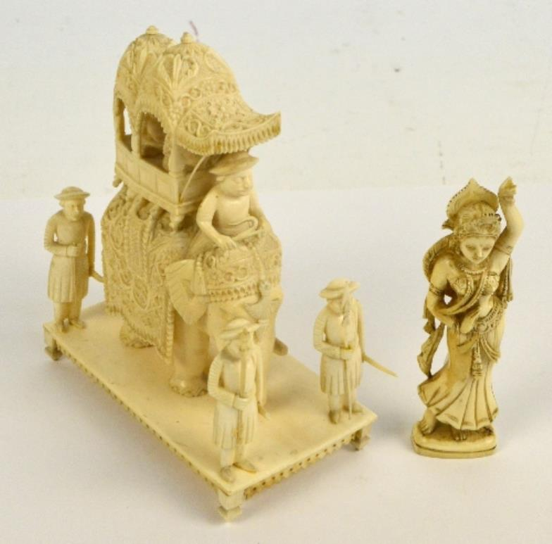 19th century antique Indian carved ivory figure group, an elephant carrying a Howdah, with two nobles surrounded by four guards on a rectangular base, and a figure of a Goddess