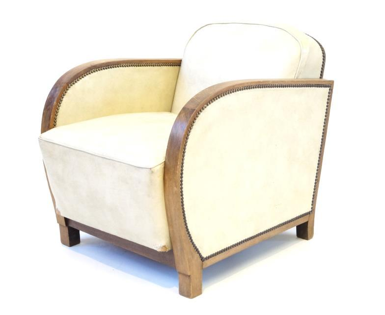 Art Deco medium oak framed armchair Upholstered in a cream leather material