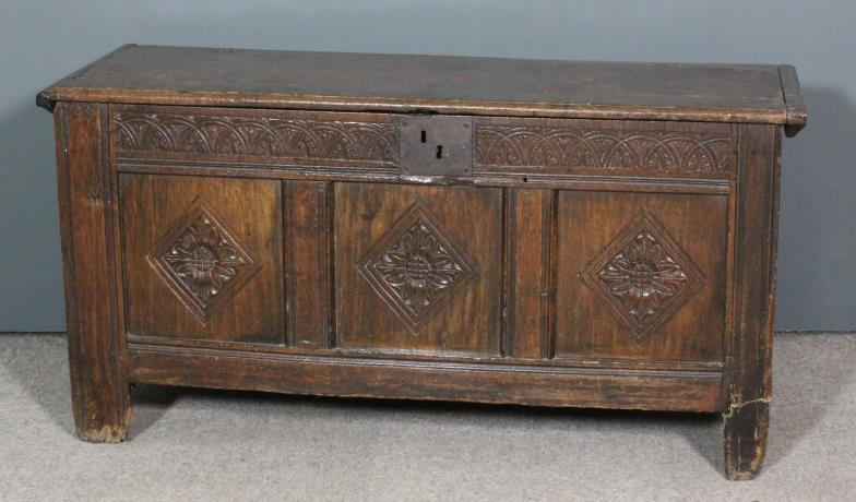<i> A late 17th Century panelled oak coffer with plain lid </i>