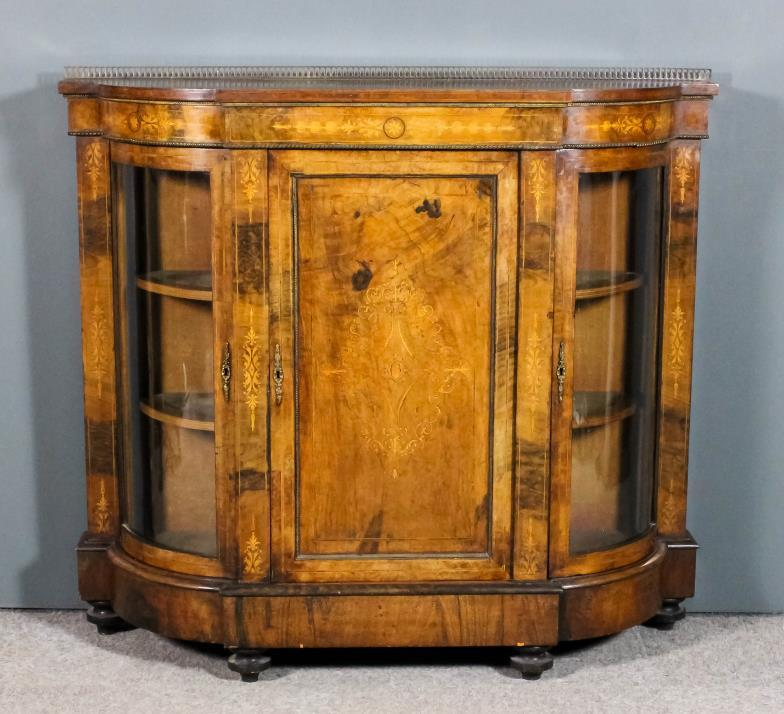 <i> A Victorian figured walnut and gilt metal <br> mounted breakfront credenza </i>