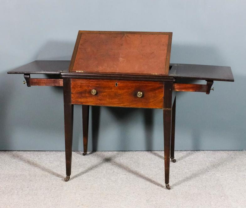 <i>A late Georgian mahogany writing/reading table</i>