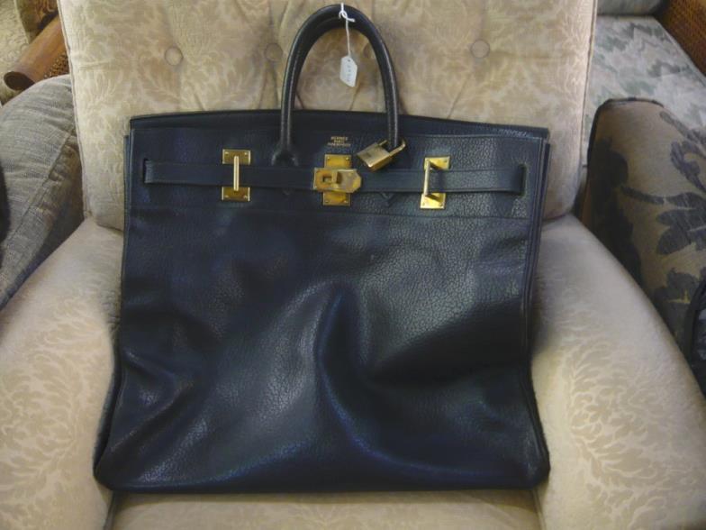 59cd58c3398 Bainbridges   A vintage Hermes Haut a Courroies black leather travel ...