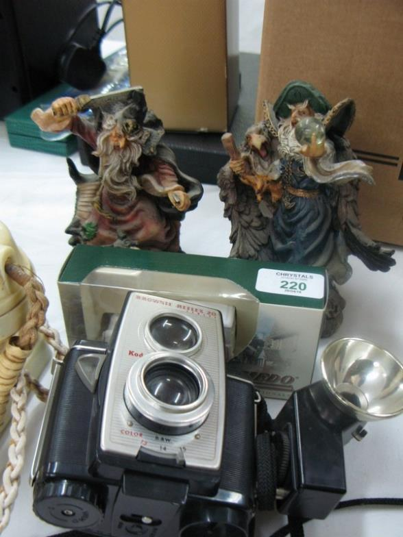 Chrystals Auctions Two Figures Of Merlin Model Car Camera And