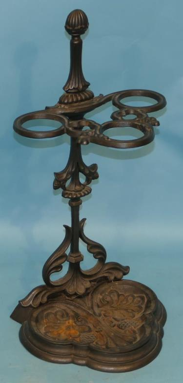 P F Windibank A Cast Iron 3 Arm Umbrella Stand Having Reeded